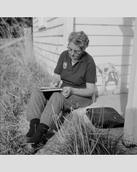 Esther Holt writing letters at Kelvedon. Image source: Tasmanian Archives TA NS3195/2/1119